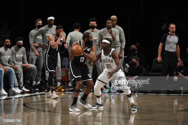 James Harden of the Brooklyn Nets handles the ball against Jrue Holiday of the Milwaukee Bucks during Round 2, Game 7 on June 19, 2021 at Barclays...