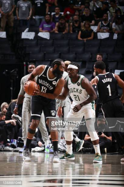 James Harden of the Brooklyn Nets handles the ball as Jrue Holiday of the Milwaukee Bucks plays defense during the game during Round 2, Game 7 of the...
