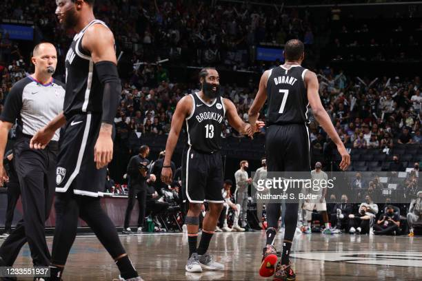 James Harden of the Brooklyn Nets high fives Kevin Durant of the Brooklyn Nets during the game against the Milwaukee Bucks during Round 2, Game 7 of...