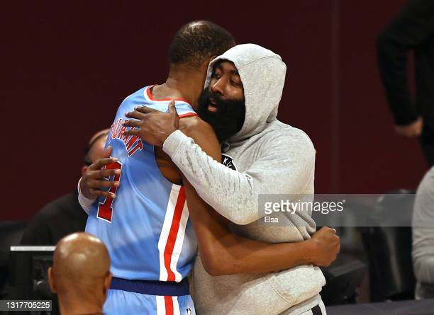 James Harden of the Brooklyn Nets hugs Kevin Durant before the game starts against the San Antonio Spurs at Barclays Center on May 12, 2021 in the...