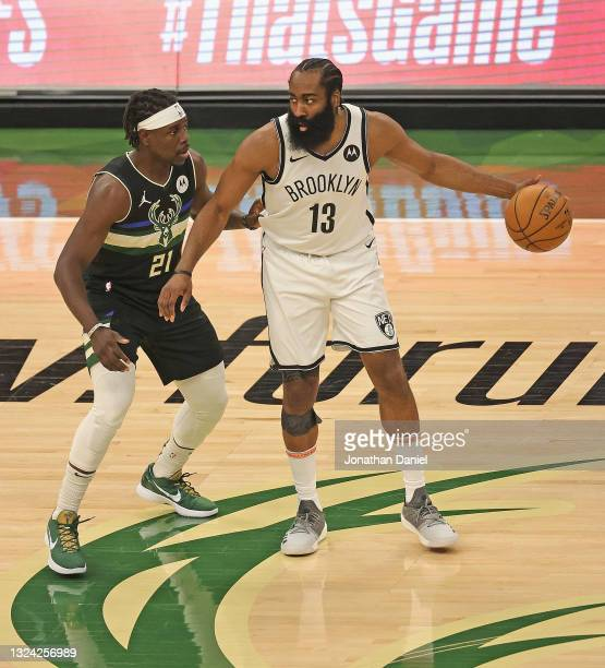 James Harden of the Brooklyn Nets moves against Jrue Holiday of the Milwaukee Bucks at Fiserv Forum on June 17, 2021 in Milwaukee, Wisconsin. The...