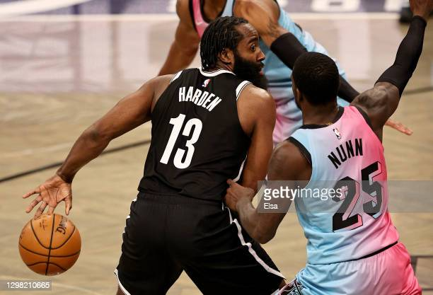 James Harden of the Brooklyn Nets passes the ball behind his back as Kendrick Nunn of the Miami Heat defends at Barclays Center on January 23, 2021...