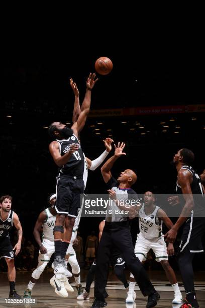 James Harden of the Brooklyn Nets reaches for the jump ball during the game against the Milwaukee Bucks during Round 2, Game 7 of the 2021 NBA...
