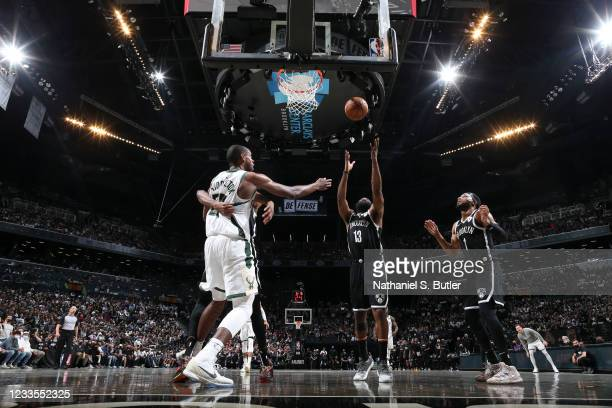 James Harden of the Brooklyn Nets rebounds the ball during the game against the Milwaukee Bucks during Round 2, Game 7 of the 2021 NBA Playoffs on...