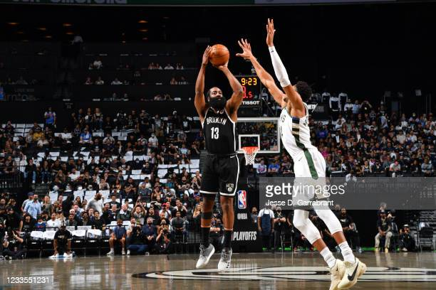 James Harden of the Brooklyn Nets shoots a three-pointer against the Milwaukee Bucks during Round 2, Game 7 on June 19, 2021 at Barclays Center in...