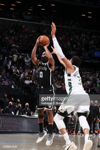James Harden of the Brooklyn Nets shoots the ball as Giannis Antetokounmpo of the Milwaukee Bucks plays defense during the game during Round 2, Game...
