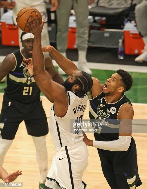 James Harden of the Brooklyn Nets shoots under pressure from Giannis Antetokounmpo of the Milwaukee Bucks at Fiserv Forum on June 17, 2021 in...