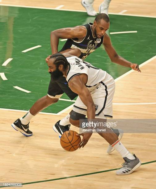 James Harden of the Brooklyn Nets steals the ball from Khris Middleton of the Milwaukee Bucks at Fiserv Forum on June 17, 2021 in Milwaukee,...