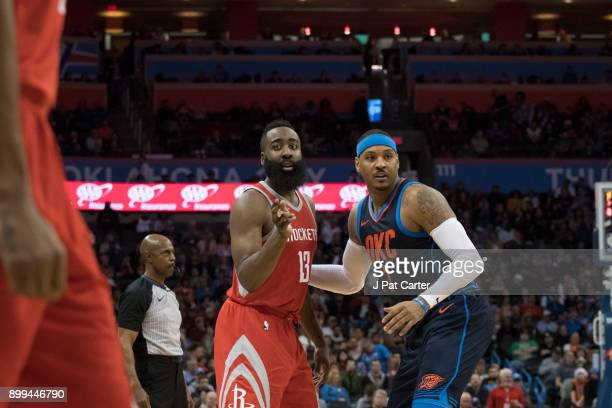 James Harden of the Houston Rockets and Carmelo Anthony of the Oklahoma City Thunder during the second half of a NBA game at the Chesapeake Energy...
