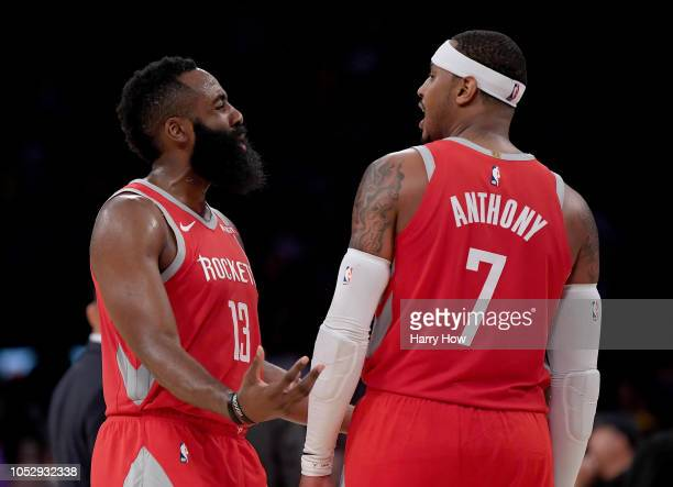 James Harden of the Houston Rockets and Carmelo Anthony of the Houston Rockets talk during a break in the game against the Los Angeles Lakers at...