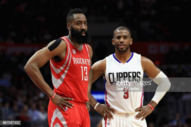 James Harden of the Houston Rockets and Chris Paul of the LA Clippers look on during the second half of a game at Staples Center on April 10 2017 in...