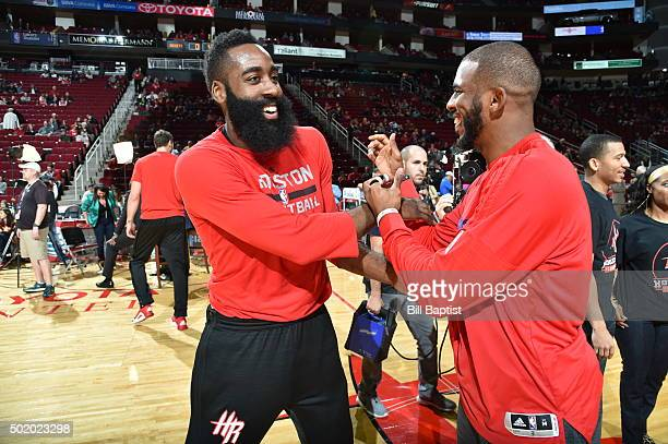 James Harden of the Houston Rockets and Chris Paul of the Los Angeles Clippers shake hands before the game on December 19 2015 at the Toyota Center...