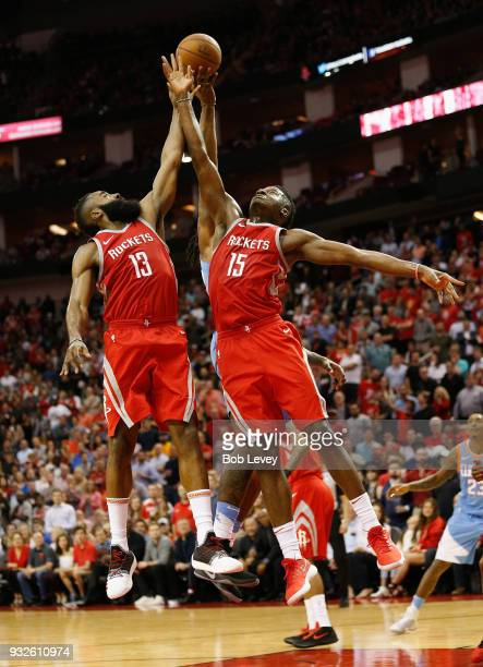 James Harden of the Houston Rockets and Clint Capela go up for a rebound in the fourth quarter at Toyota Center on March 15 2018 in Houston Texas...