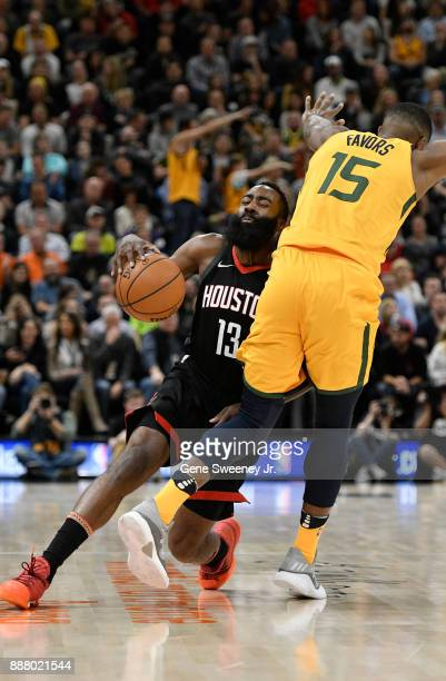 James Harden of the Houston Rockets and Derrick Favors of the Utah Jazz collide in the first half at Vivint Smart Home Arena on December 7 2017 in...