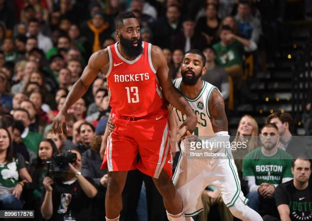 James Harden of the Houston Rockets and Kyrie Irving of the Boston Celtics defend during the game between the two teams on December 28 2017 at the TD...