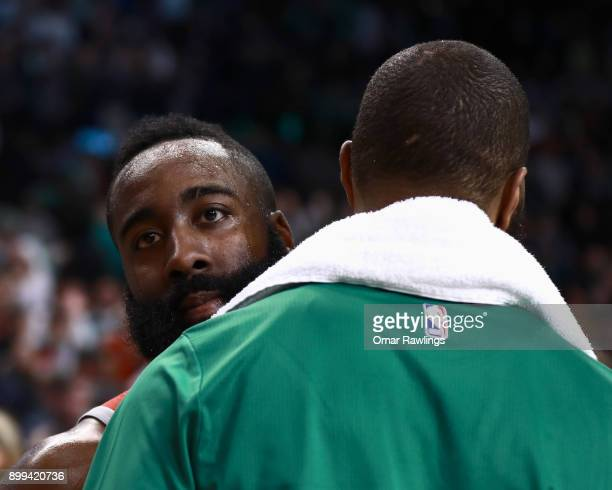 James Harden of the Houston Rockets and Marcus Morris of the Boston Celtics talk after the game at TD Garden on December 28 2017 in Boston...