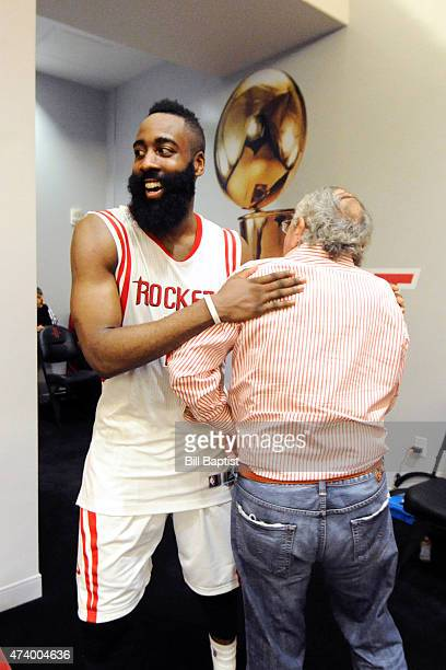James Harden of the Houston Rockets and owner Leslie Alexander celebrates after the win against the Los Angeles Clippers in Game Seven of the Western...
