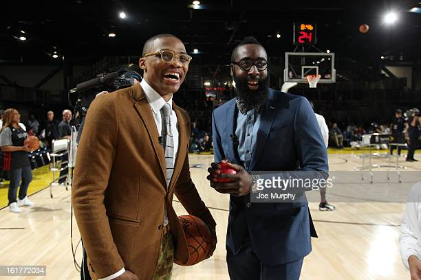 James Harden of the Houston Rockets and Russell Westbrook of the Oklahoma City Thunder pose during the Sprint Celebrity Game at Jam Session during...