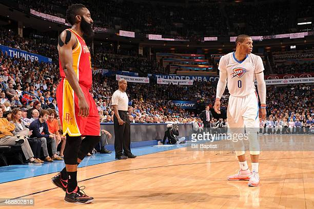 James Harden of the Houston Rockets and Russell Westbrook of the Oklahoma City Thunder stand on the court together on April 5 2015 at Chesapeake...