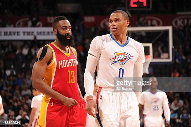 James Harden of the Houston Rockets and Russell Westbrook of the Oklahoma City Thunder walk off the court on April 5 2015 at Chesapeake Energy Arena...