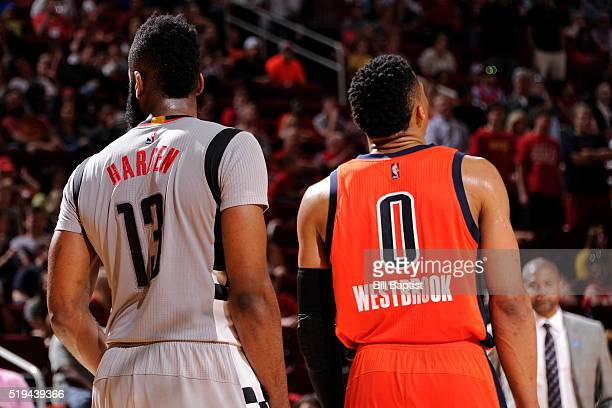 James Harden of the Houston Rockets and Russell Westbrook of the Oklahoma City Thunder stand on the court together during the game on April 3 2016 at...