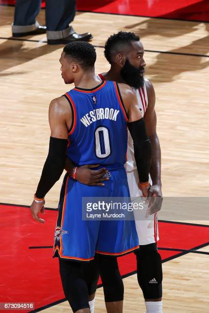 James Harden of the Houston Rockets and Russell Westbrook of the Oklahoma City Thunder share a hug after the game in Game Five of the Western...