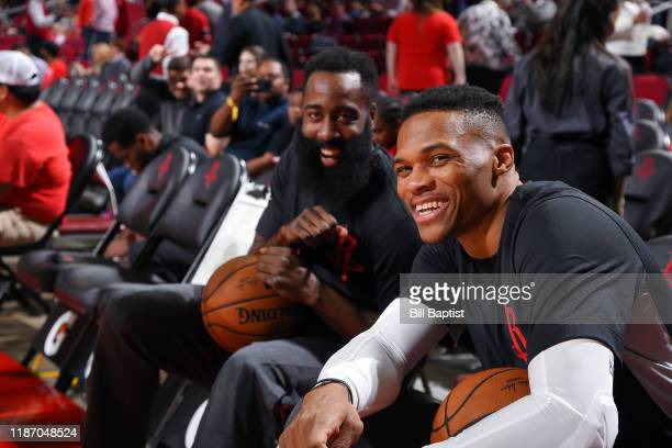 James Harden of the Houston Rockets and Russell Westbrook smile before the game against the Phoenix Suns on December 7 2019 at the Toyota Center in...