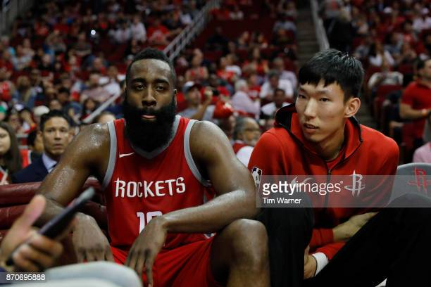 James Harden of the Houston Rockets and Zhou Qi of the Houston Rockets sit on the bench in the second half against the Utah Jazz at Toyota Center on...