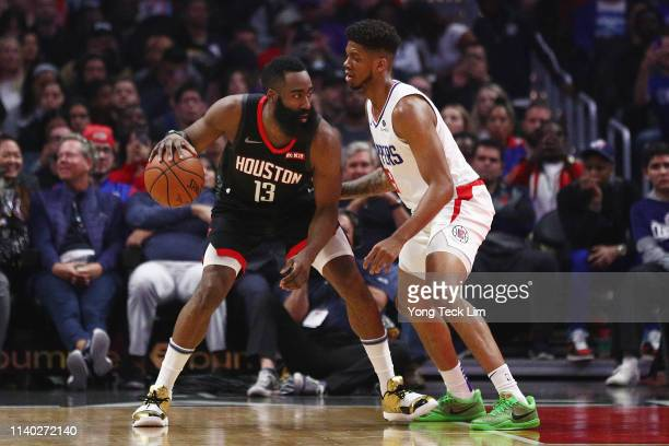 James Harden of the Houston Rockets backs down against Tyrone Wallace of the Los Angeles Clippers during the first half at Staples Center on April...