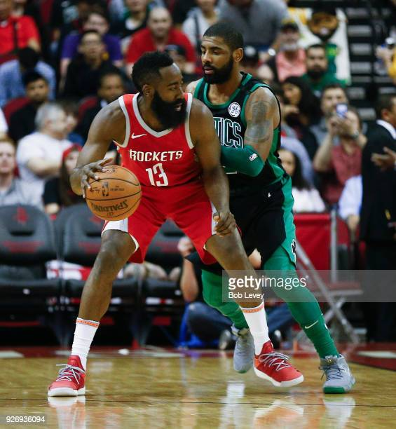 James Harden of the Houston Rockets backs in against Kyrie Irving of the Boston Celtics in the firt quarter at Toyota Center on March 3 2018 in...