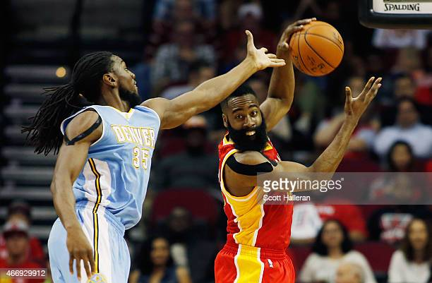 James Harden of the Houston Rockets battles for a rebound with Kenneth Faried of the Denver Nuggets during their game at the Toyota Center on March...
