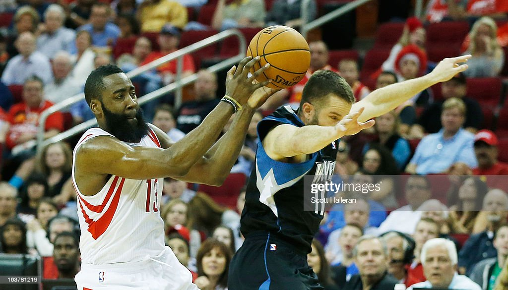 James Harden #13 of the Houston Rockets battles for the ball against J.J. Barea #11 of the Minnesota Timberwolves at Toyota Center on March 15, 2013 in Houston, Texas.