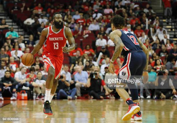 James Harden of the Houston Rockets brings the ball down the court defended by Kelly Oubre Jr #12 of the Washington Wizards in the first half at...