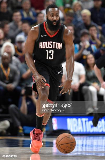 James Harden of the Houston Rockets brings the ball up court against the Utah Jazz during their game at Vivint Smart Home Arena on December 7 2017 in...