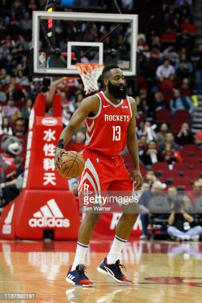 James Harden of the Houston Rockets brings the ball up court in the first half against the Phoenix Suns at Toyota Center on March 15 2019 in Houston...