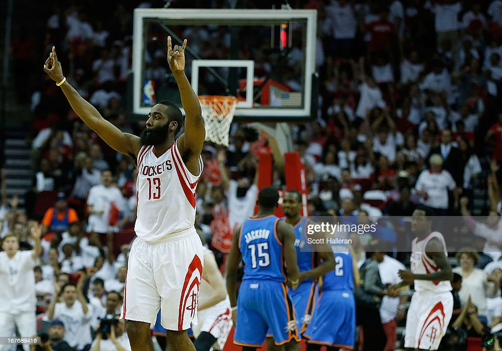 James Harden #13 of the Houston Rockets celebrates a play against the Oklahoma Thunder in Game Three of the Western Conference Quarterfinals of the 2013 NBA Playoffs at the Toyota Center on April 27, 2013 in Houston, Texas.