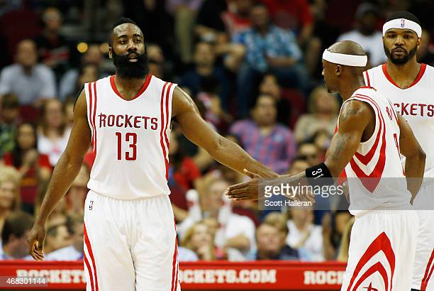 James Harden of the Houston Rockets celebrates a play with teammate Jason Terry during their game against the Sacramento Kings at the Toyota Center...