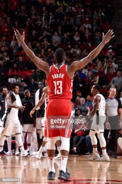 James Harden of the Houston Rockets celebrates a score during the game against the Milwaukee Bucks on December 16 2017 at the Toyota Center in...