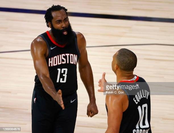 James Harden of the Houston Rockets celebrates a steal by Eric Gordon of the Houston Rockets during the third quarter in Game Five of the Western...