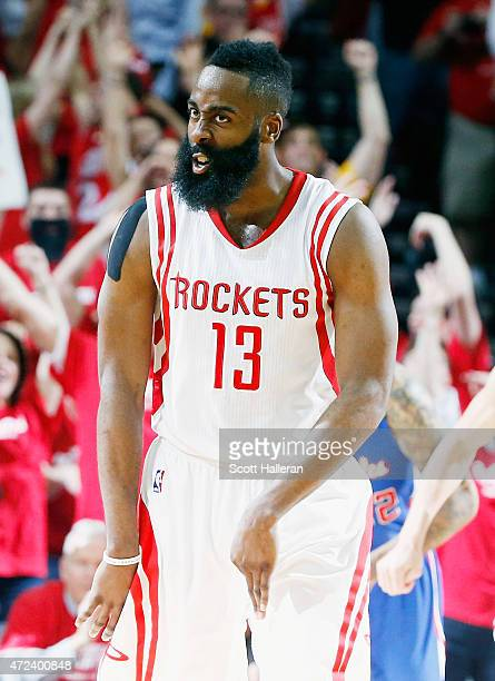 James Harden of the Houston Rockets celebrates a three point shot late in the second half against the Los Angeles Clippers during Game Two in the...
