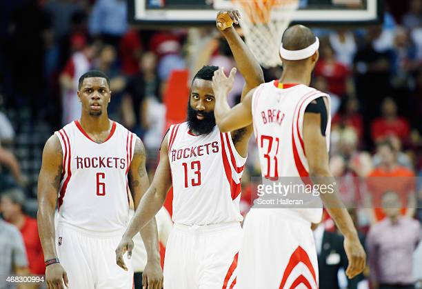 James Harden of the Houston Rockets celebrates a threepoint shot with teammates Corey Brewer during their game against the Sacramento Kings at the...