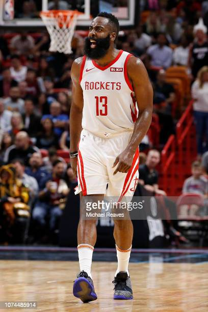 James Harden of the Houston Rockets celebrates after a basket against the Miami Heat during the second half at American Airlines Arena on December...