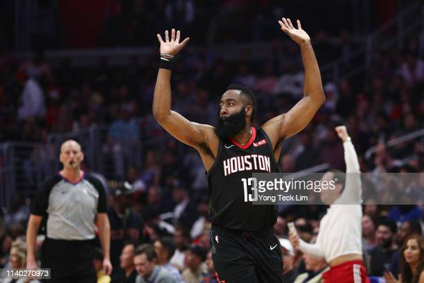 James Harden of the Houston Rockets celebrates after a dunk by Clint Capela against the Los Angeles Clippers during the first half at Staples Center...