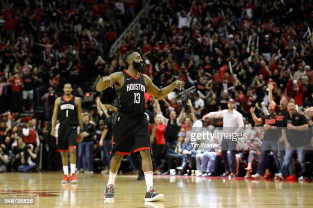 James Harden of the Houston Rockets celebrates after a threepoint shot in the second half during Game One of the first round of the 2018 NBA Playoffs...