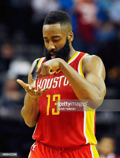 James Harden of the Houston Rockets celebrates after a threepoint shot on the court during their game against the Denver Nuggets at the Toyota Center...