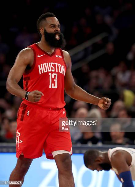 James Harden of the Houston Rockets celebrates after teammate Gerald Green dunked in the third quarter against the New York Knicks at Madison Square...