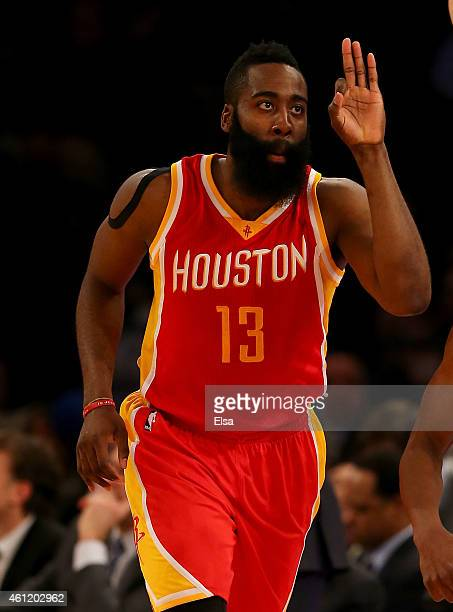 James Harden of the Houston Rockets celebrates his three pointer in the second half against the New York Knicks at Madison Square Garden on January 8...