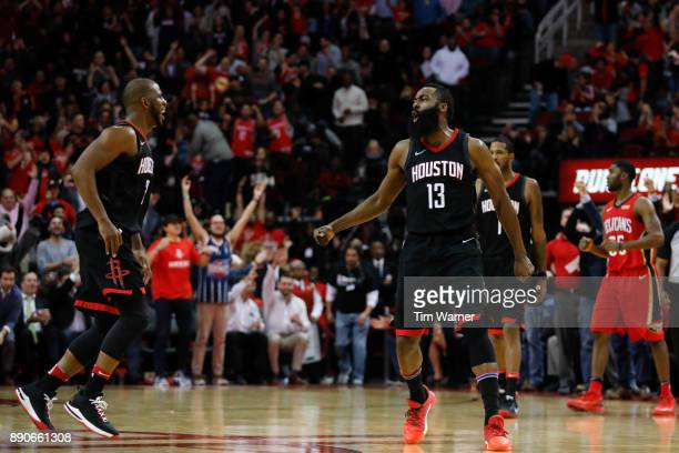 James Harden of the Houston Rockets celebrates with Chris Paul after a foul in the fourth quarter against the New Orleans Pelicans at Toyota Center...