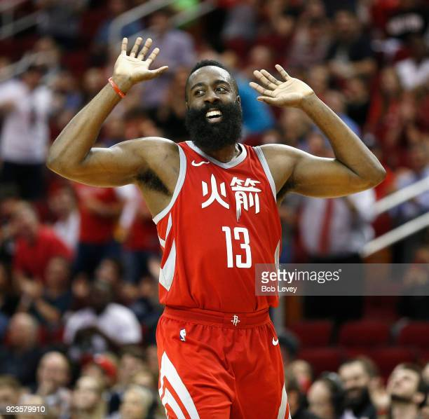 James Harden of the Houston Rockets celebrates with the crowd after Chris Paul makes a shot in the fourth quarter against the Minnesota Timberwolves...