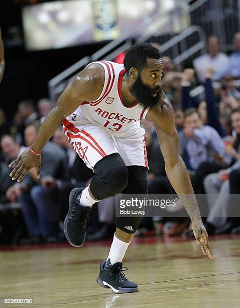 James Harden of the Houston Rockets celerbates after making a threepoint shot against the Sacramento Kings at Toyota Center on December 14 2016 in...